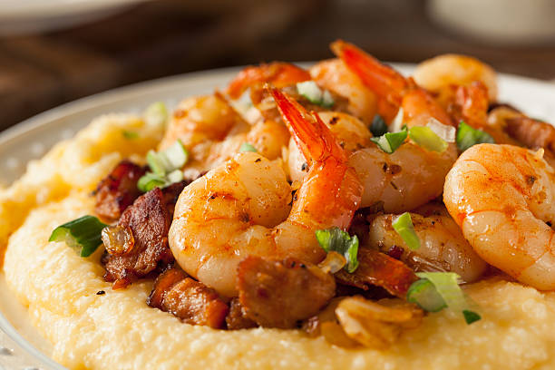 homemade shrimp and grits - caribbean culture stock pictures, royalty-free photos & images