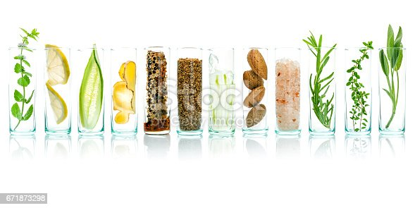 istock Homemade skin care with natural ingredients aloe vera, lemon, cucumber, himalayan salt, peppermint, rosemary, almonds, cucumber, ginger and honey pollen isolated on white background. 671873298