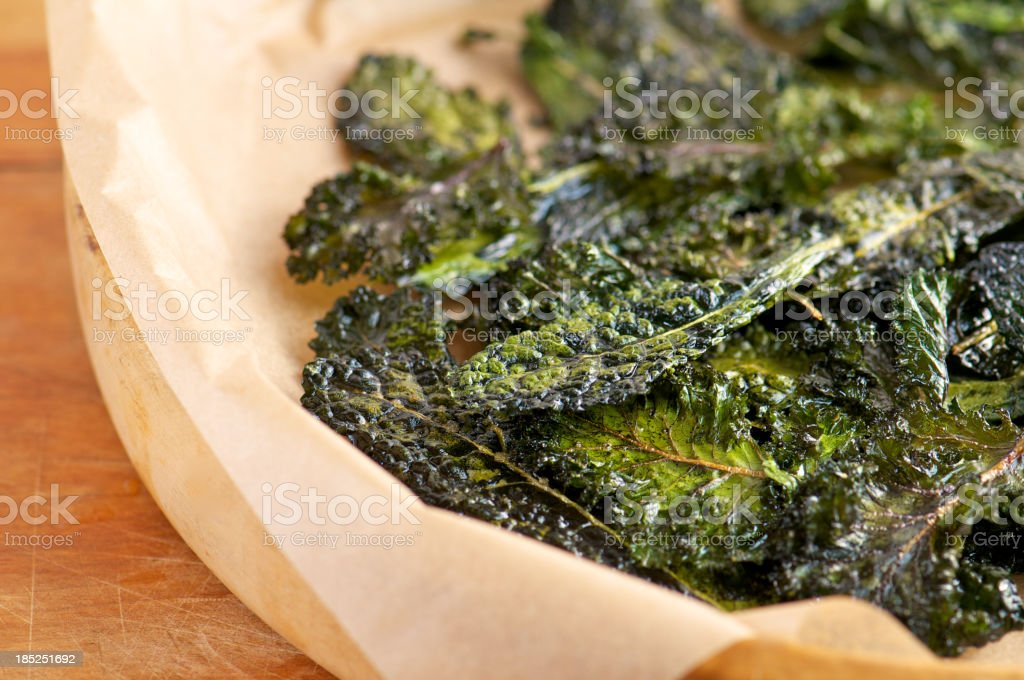 Homemade Slow-Roasted Kale Chips stock photo