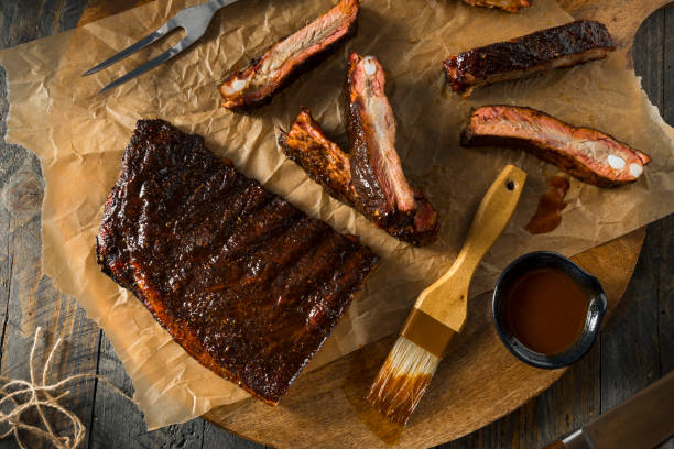 homemade smoked barbecue st. louis style pork ribs - ribs stock photos and pictures