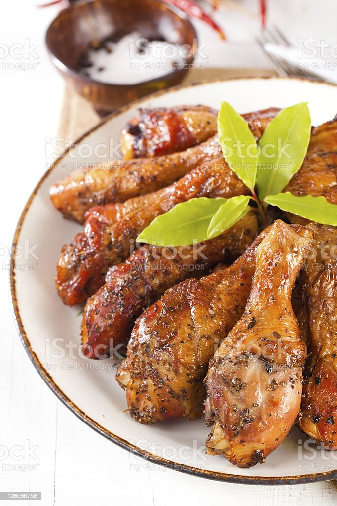 homemade smoked  chicken drumsticks on a plate royalty-free stock photo