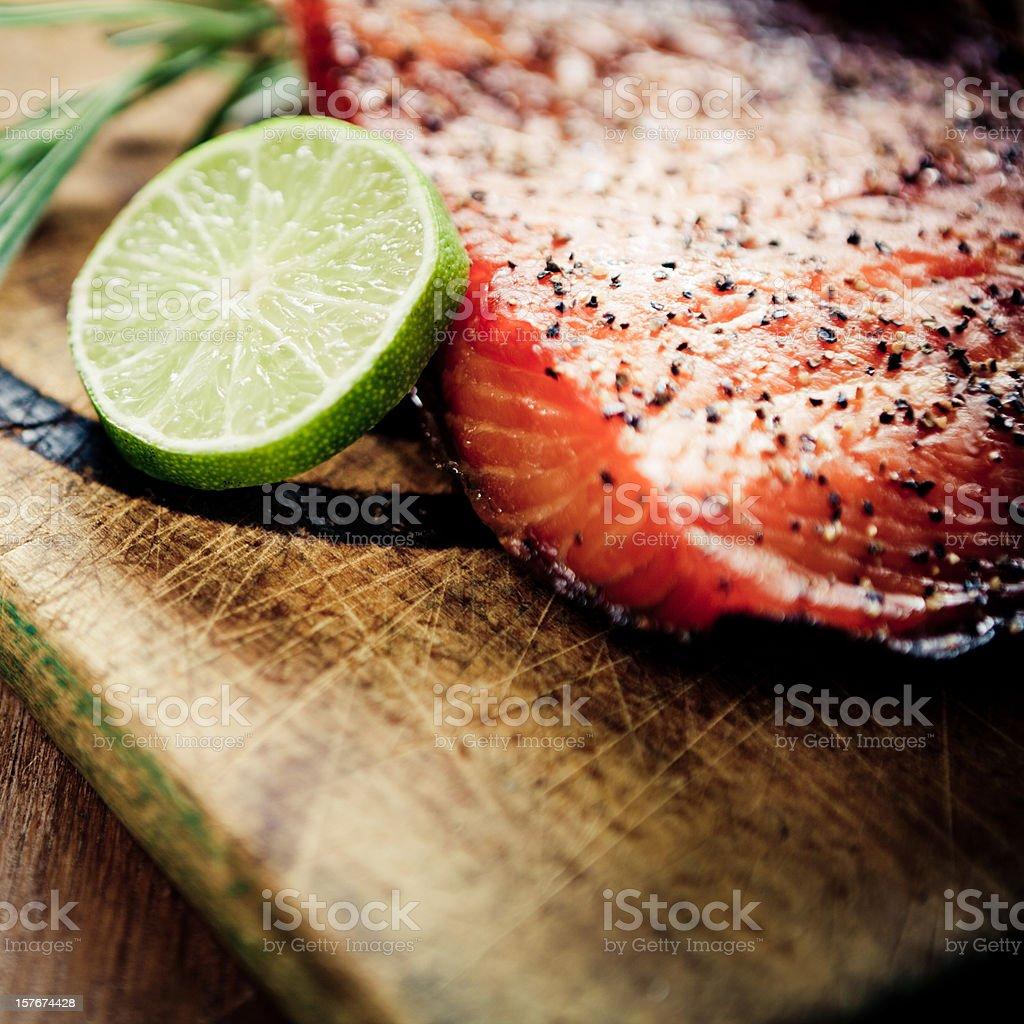 A homemade smoked salmon with lime stock photo