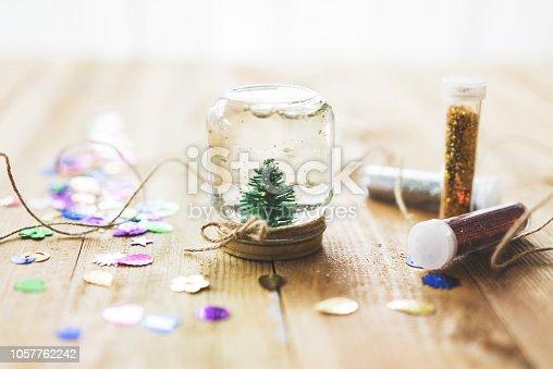 Homemade snow globe, christmas tree in a jar