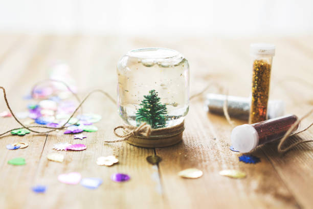 Homemade snow globe Homemade snow globe, christmas tree in a jar homemade stock pictures, royalty-free photos & images