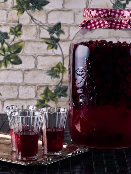 Homemade sour cherry liqueur stock photo
