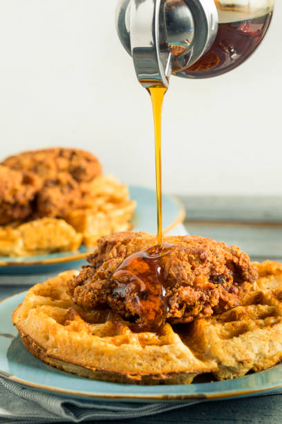 Homemade Southern Chicken and Waffles Homemade Southern Chicken and Waffles with Syrup waffle stock pictures, royalty-free photos & images