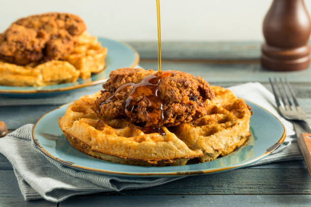 Homemade Southern Chicken and Waffles Homemade Southern Chicken and Waffles with Syrup chicken meat stock pictures, royalty-free photos & images