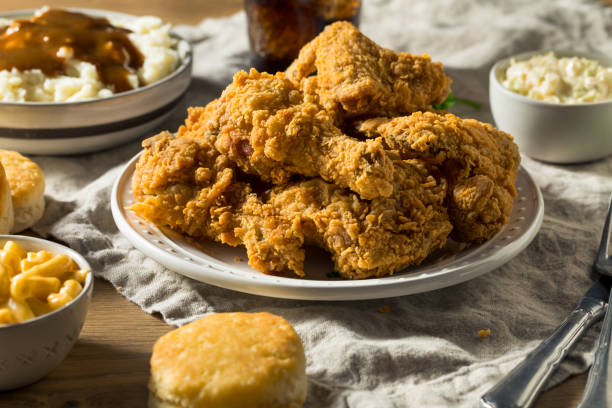 Homemade Southern Fried Chicken Dinner Homemade Southern Fried Chicken Dinner with Sides fried chicken stock pictures, royalty-free photos & images