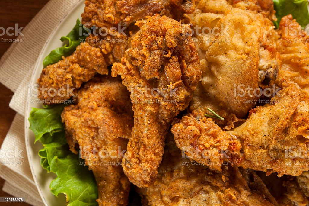 Homemade southern fried chicken on a bed of lettuce leaves stock photo