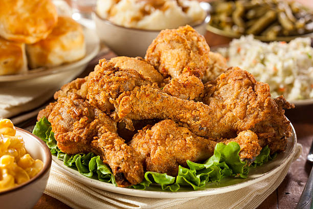 Homemade Southern Fried Chicken Homemade Southern Fried Chicken with Biscuits and Mashed Potatoes fried chicken stock pictures, royalty-free photos & images
