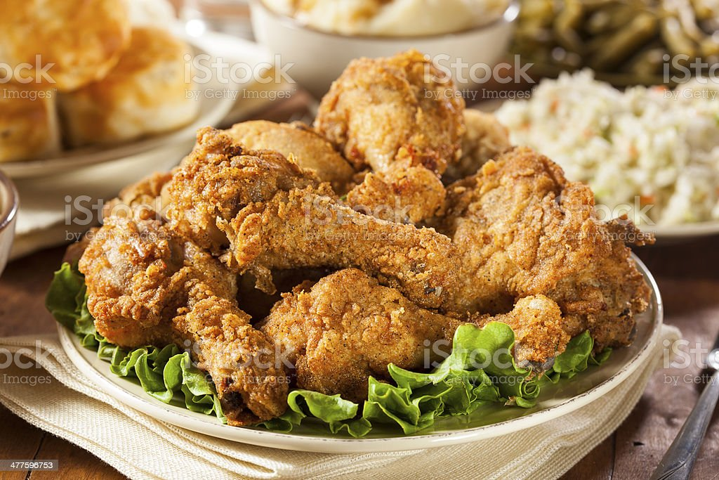 Homemade Southern Fried Chicken Homemade Southern Fried Chicken with Biscuits and Mashed Potatoes Animal Body Part Stock Photo
