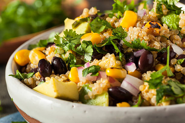Homemade Southwestern Mexican Quinoa Salad Homemade Southwestern Mexican Quinoa Salad with Beans Corn and Cilantro rice cereal plant stock pictures, royalty-free photos & images