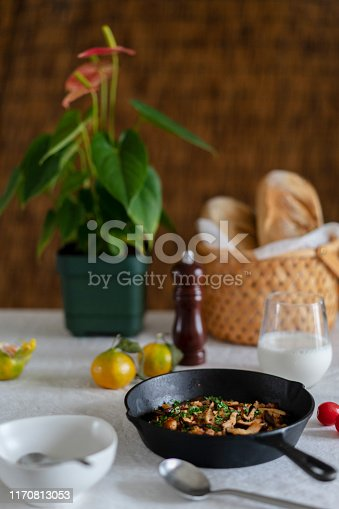 homemade spicy fried rice with mushroom, onion and leaf vegetable