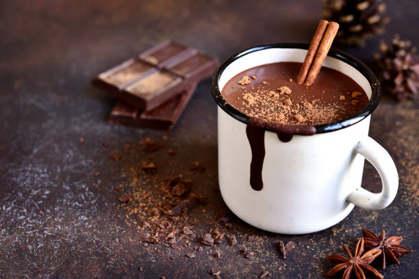 homemade spicy hot chocolate with cinnamon - hot chocolate stock photos and pictures