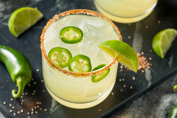 Homemade Spicy Margarita with Limes Homemade Spicy Margarita with Limes and Jalapenos jalapeno pepper stock pictures, royalty-free photos & images