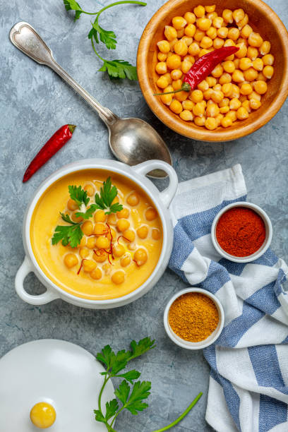 Homemade spicy pumpkin soup with chickpeas. stock photo