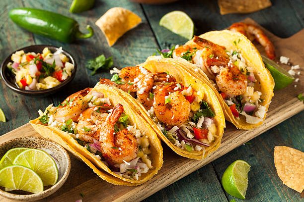 homemade spicy shrimp tacos - mexican food stock photos and pictures