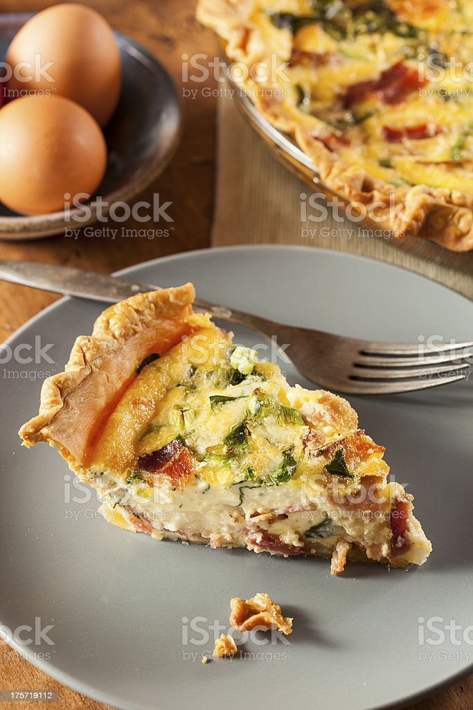 Homemade Spinach and Bacon Egg Quiche royalty-free stock photo