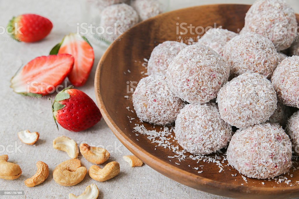 Homemade strawberry, date, cashew and coconut bliss ball foto royalty-free