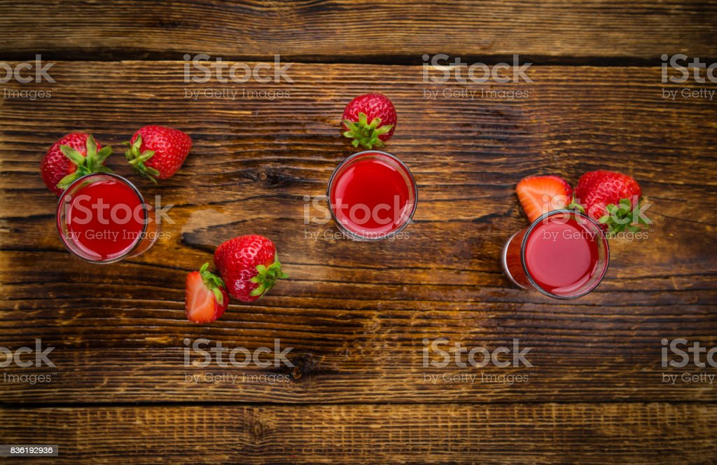 Homemade Strawberry liqueur stock photo