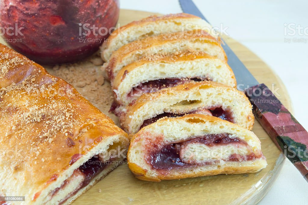 Homemade strudel with strawberry jam stock photo