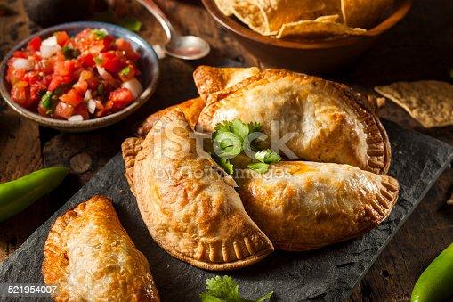Homemade Stuffed Chicken Empanadas on a Background