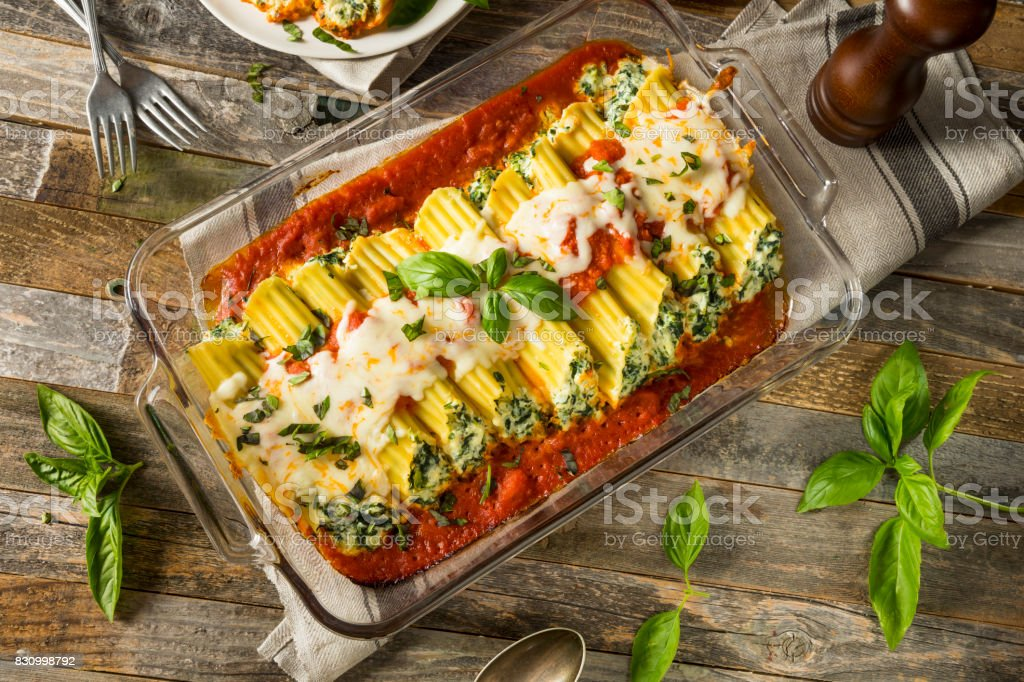 Homemade Stuffed Ricotta and Spinach Manicotti stock photo