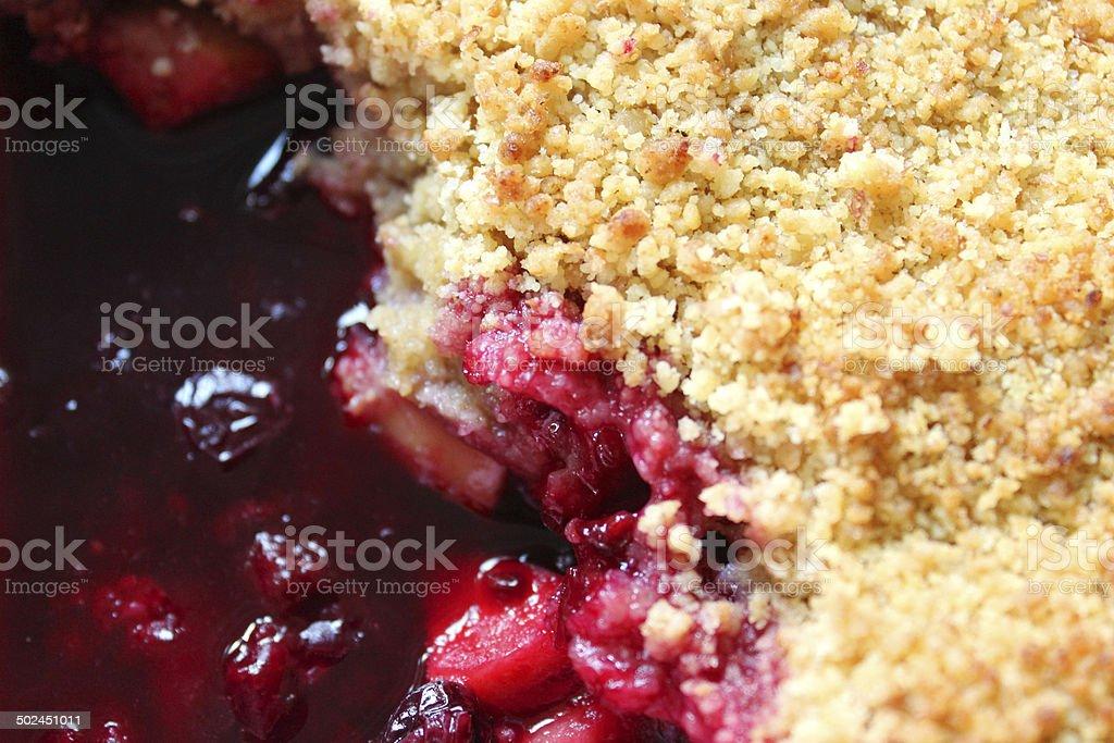 Homemade summer fruit crumble with apple, blackberries, raspberries, blueberries, cherries stock photo