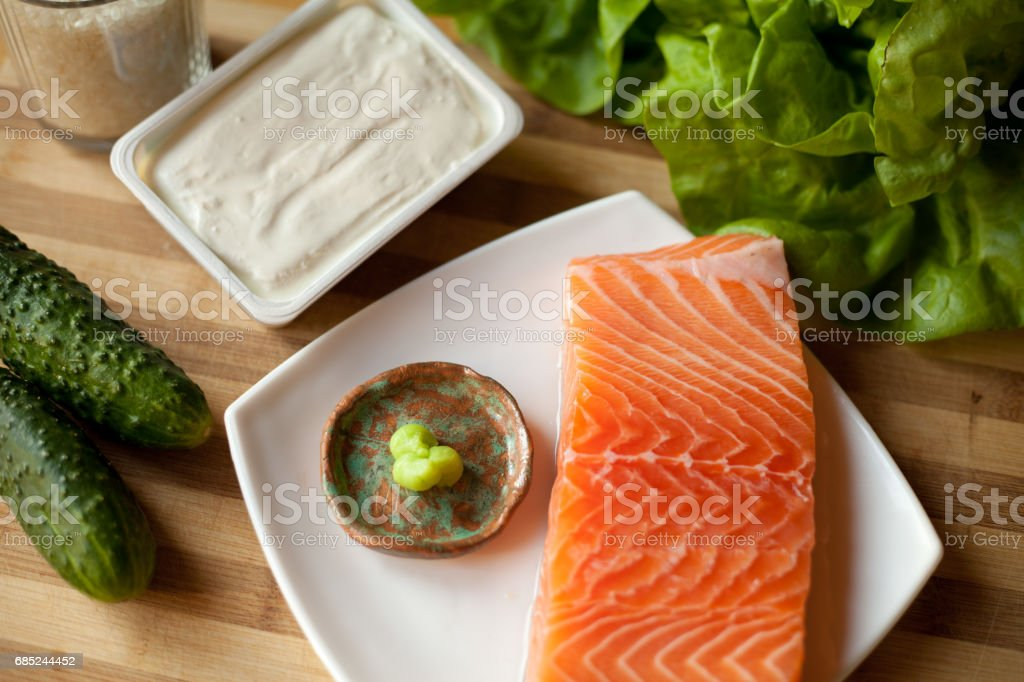 Homemade sushi with salmon -  preparation process and ingredients. royalty-free stock photo