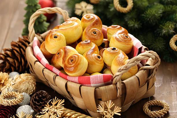 homemade swedish saffron buns, lussekatt in basket homemade swedish saffron buns, lussekatt in basket sweet bun stock pictures, royalty-free photos & images