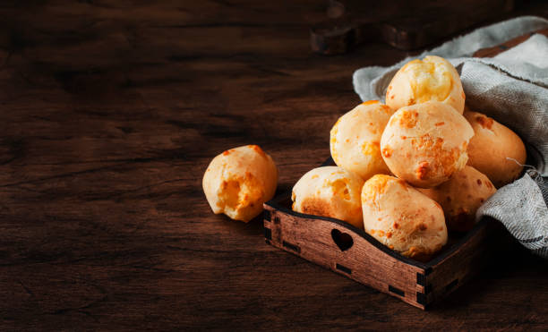 Homemade sweet custard buns, wooden bowl, rustic kitchen table background, place for text, selective focus Homemade sweet custard buns, wooden bowl, rustic kitchen table background, place for text, selective focus sweet bun stock pictures, royalty-free photos & images