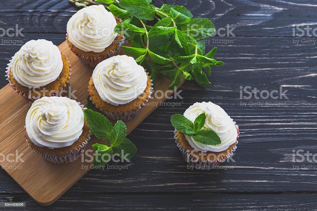 Homemade sweet mint cupcake with cream stock photo
