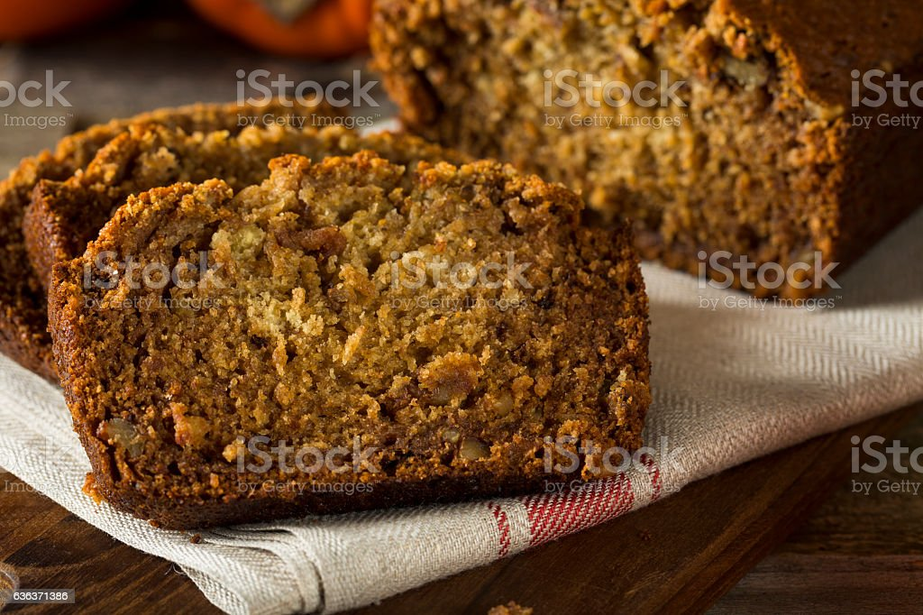 Homemade Sweet Persimmon and Nut Bread stock photo