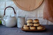 homemade sweet sesame cake, pottery teapot and teacup