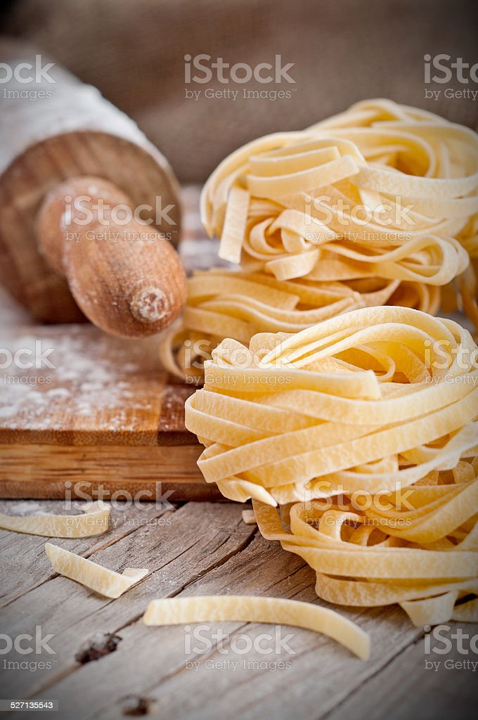 Homemade tagliatelle. Raw pasta on the wooden table stock photo