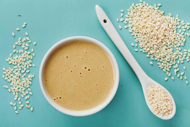 Homemade tahini or tahina, paste from ground sesame seeds stock photo
