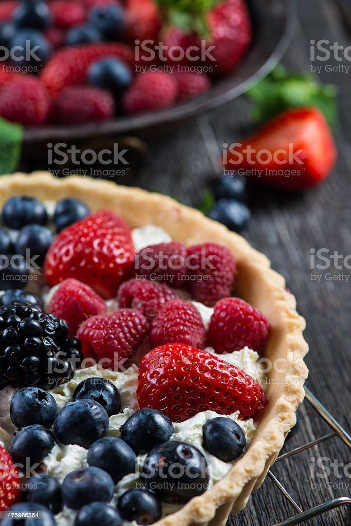Homemade tart with fresh berries summer fruit stock photo