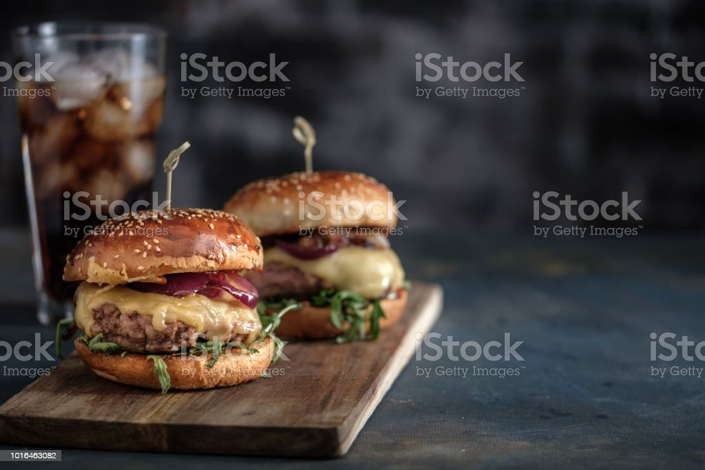 Homemade tasty hamburger with beef, cheese and caramelized onions. Street food, fast food. Copyspace стоковое фото