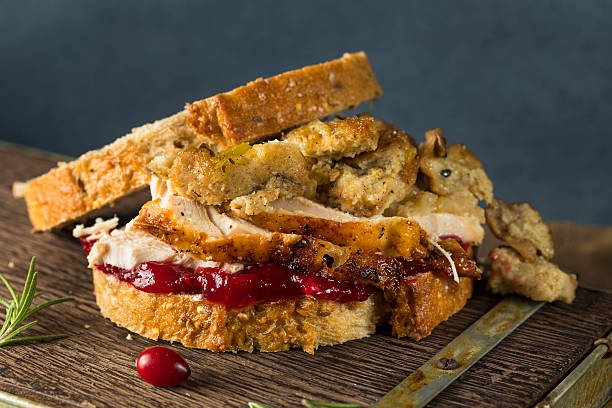 Homemade Thanksgiving Leftover Turkey Sandwich Homemade Thanksgiving Leftover Turkey Sandwich with Stuffing and Cranberry leftovers stock pictures, royalty-free photos & images