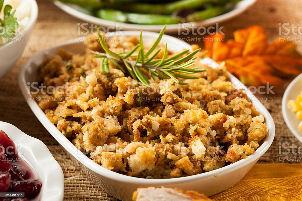Homemade thanksgiving stuffing in a white bowl stock photo