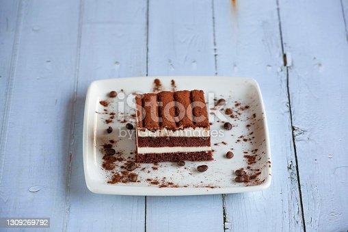 istock Homemade tiramisu cake on wood background 1309269792