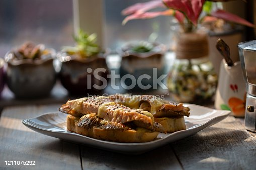 homemade toasted bread, with mushroom, salmon and mozzarella