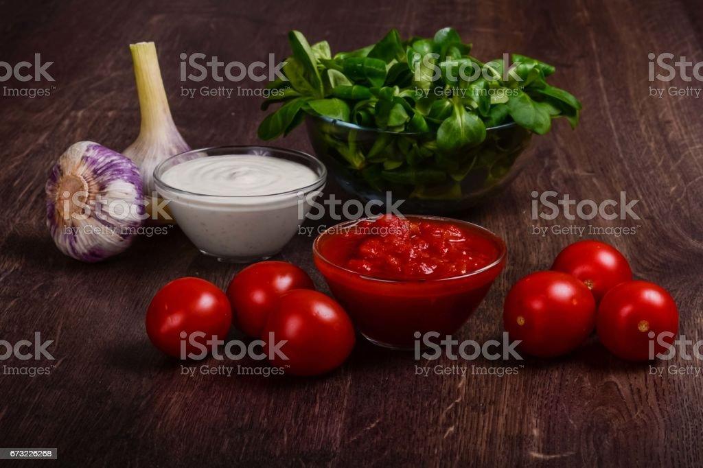 Homemade tomato and garlic cream sauces. stock photo