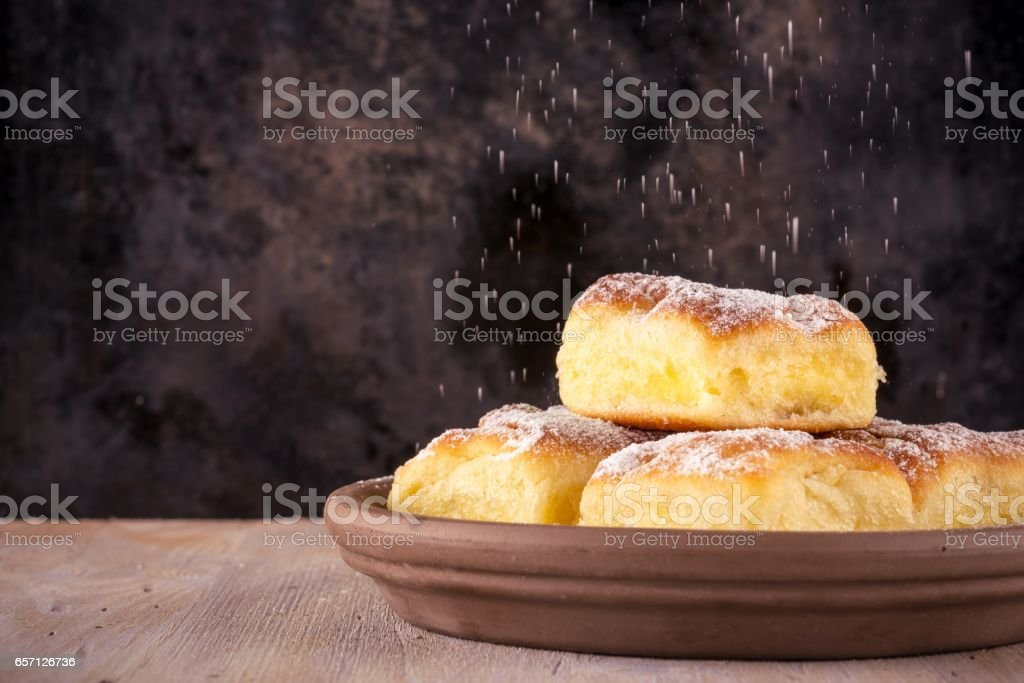Homemade traditional cakes filled by curd with powder sugar stock photo