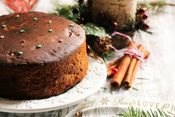 Homemade Traditional Christmas cake on festive rustic white wood, seective focus stock photo