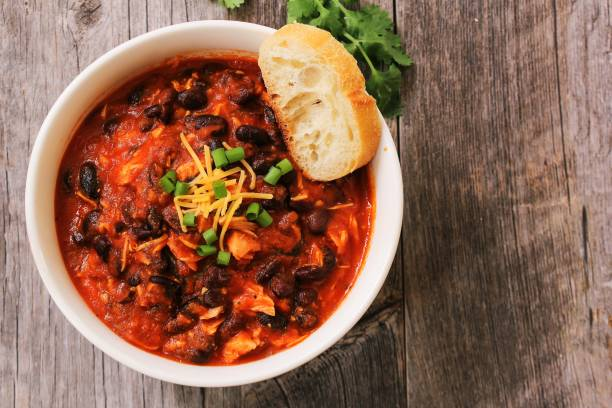 Homemade Turkey Chili with beans and scallions / Thanksgiving Leftovers Homemade Turkey Chili with beans and scallions / Thanksgiving Leftovers thanksgiving leftovers stock pictures, royalty-free photos & images