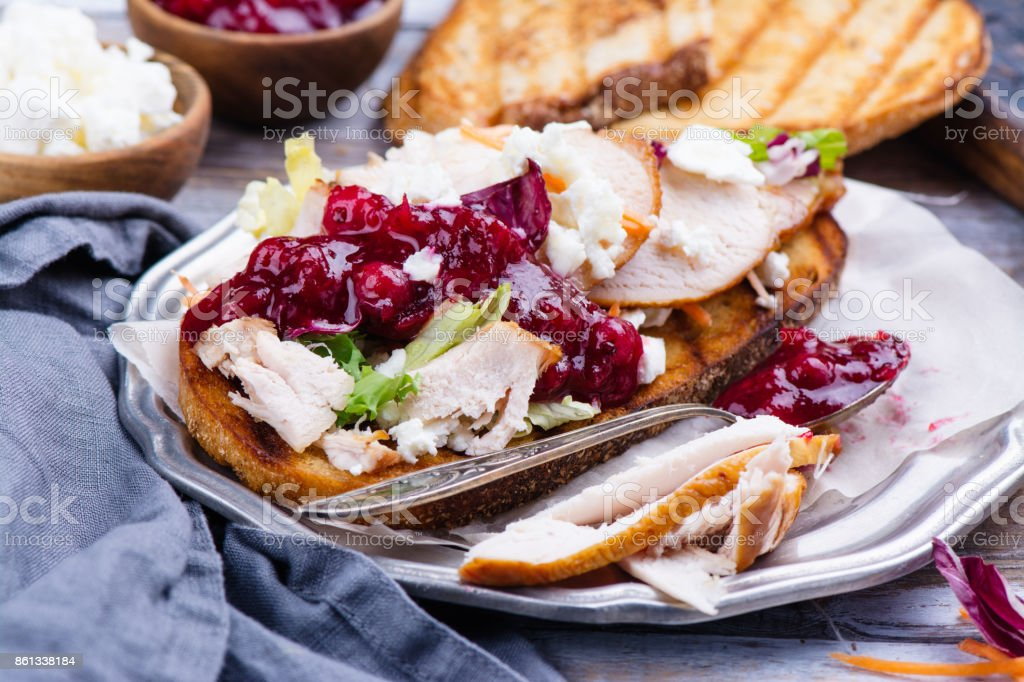 Homemade turkey leftover sandwich with cranberry sauce stock photo