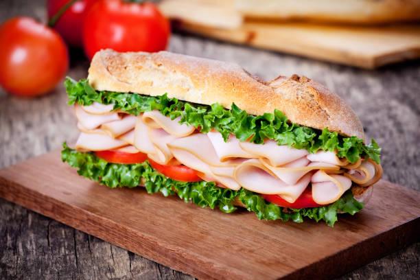homemade turkey tomato and lettuce sandwich - panino ripieno foto e immagini stock