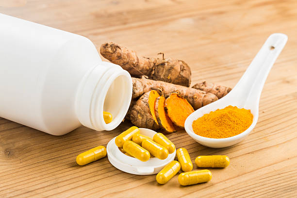 Homemade turmeric capsule from freshly grounded turmeric roots. Homemade turmeric capsule from freshly grounded turmeric roots anti inflammatory stock pictures, royalty-free photos & images