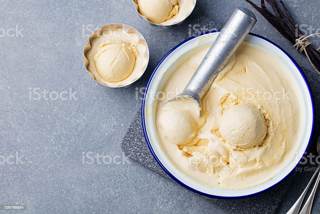 Homemade vanilla, caramel ice cream in vintage bowl Organic product stock photo